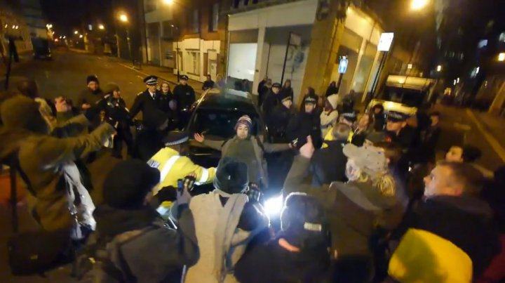Occupy London protester tries to stop bailiff driving away from an eviction of one of their squats