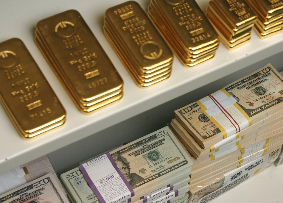 Gold bars and dollar bills of various denominations