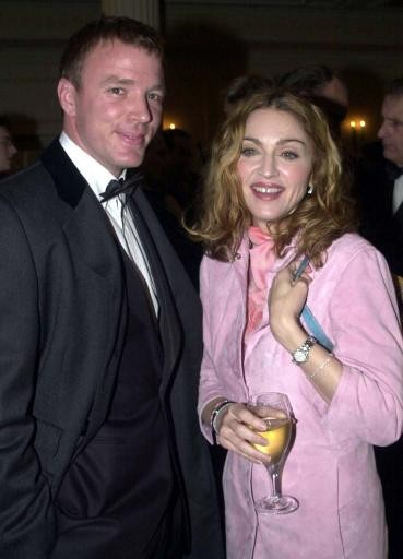 American singer Madonna carrying a Fendi handbag with her boyfriend British film director Guy Ritchie