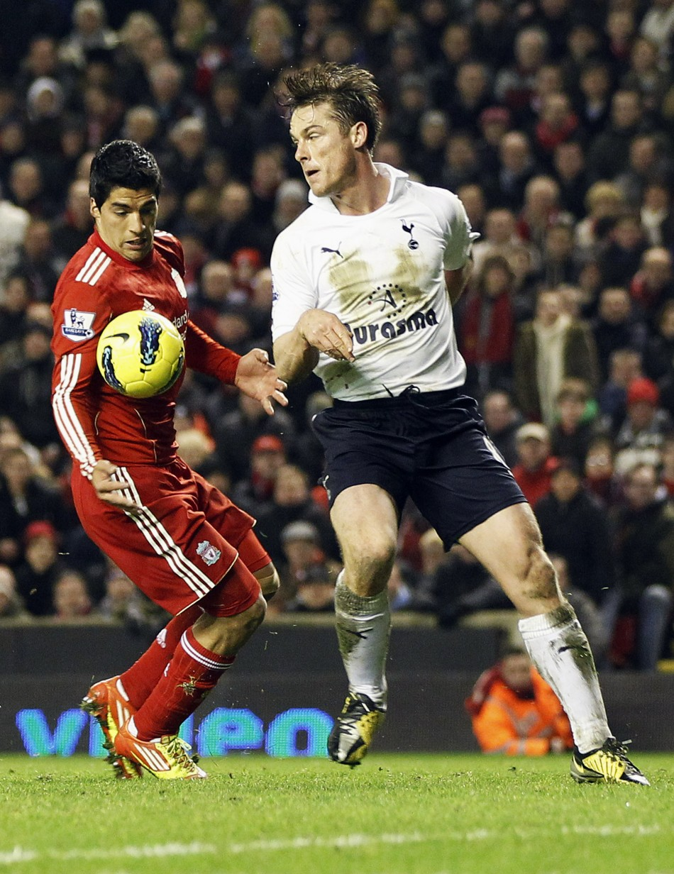 Liverpool's Suarez challenges Tottenham Hotspur's Parker during their English Premier League soccer match at Anfield