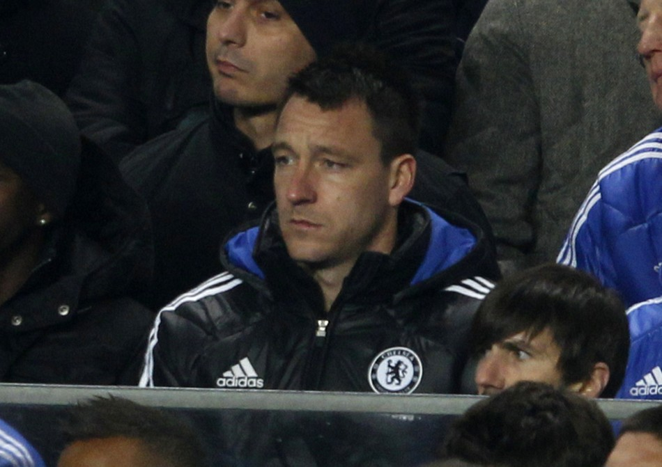 Chelsea's John Terry watches his team during their English Premier League soccer match against Manchester United at Stamford Bridge in London