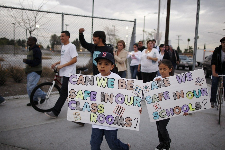 Parents and students of Miramonte Elementary School protest (Reuters)
