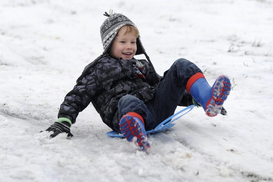 Boy rides sledge