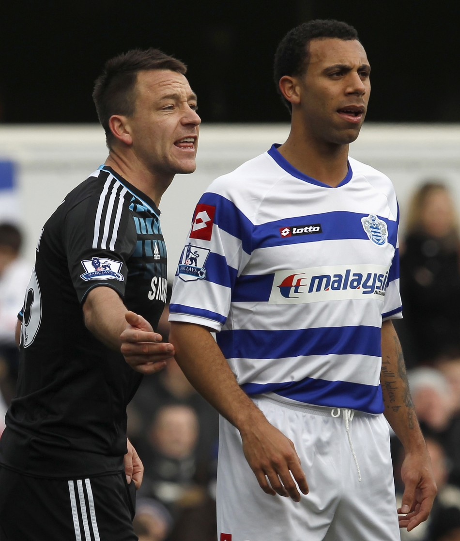 Queens Park Rangers' Anton Ferdinand is marked by Chelsea's John Terry before a corner kick during their FA Cup soccer match at Loftus Road in London