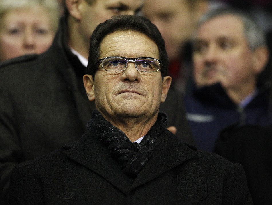 England manager Fabio Capello waits for the start of the English Premier League soccer match between Liverpool and Tottenham Hotspur at Anfield in Liverpool