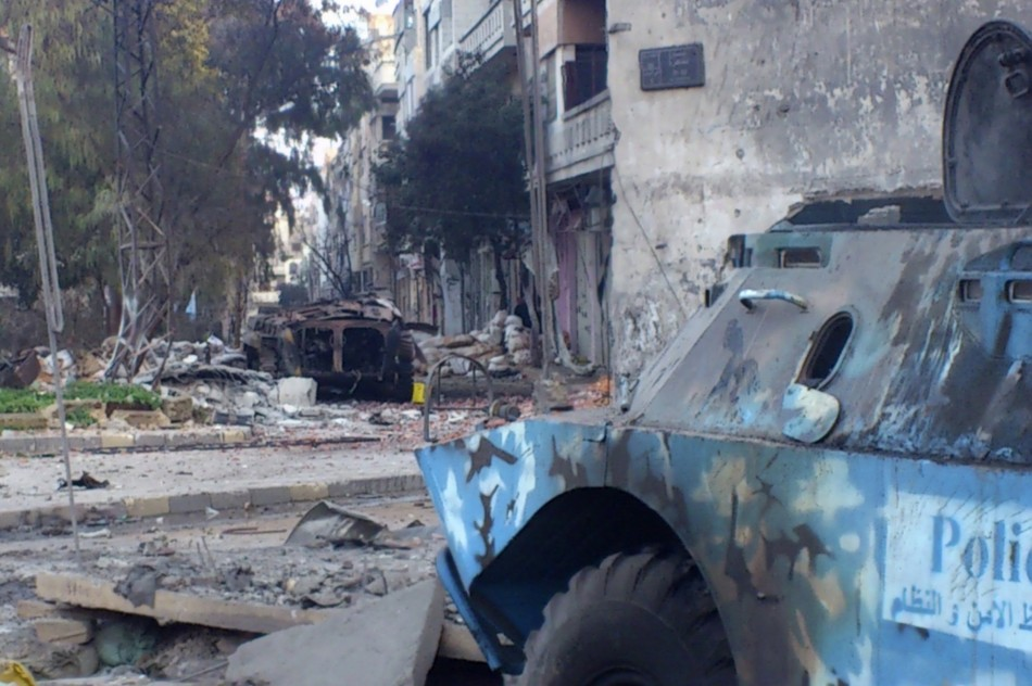 Wreckage of armoured military vehicles after clashes near Khaldiyeh area in Homs