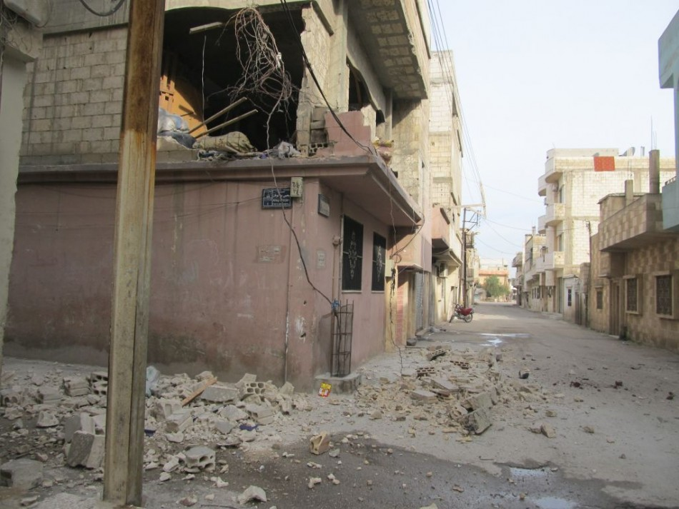 A building destroyed by bombardments in Homs