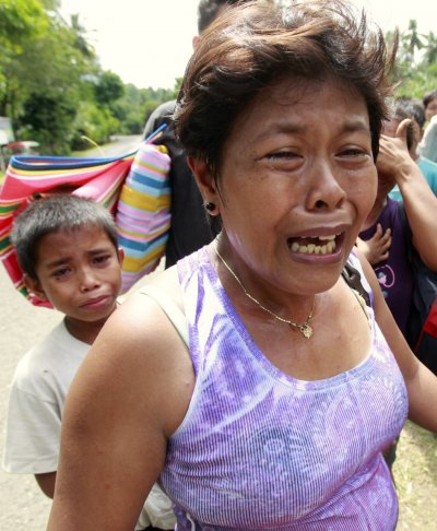 Earthquake survivors weep