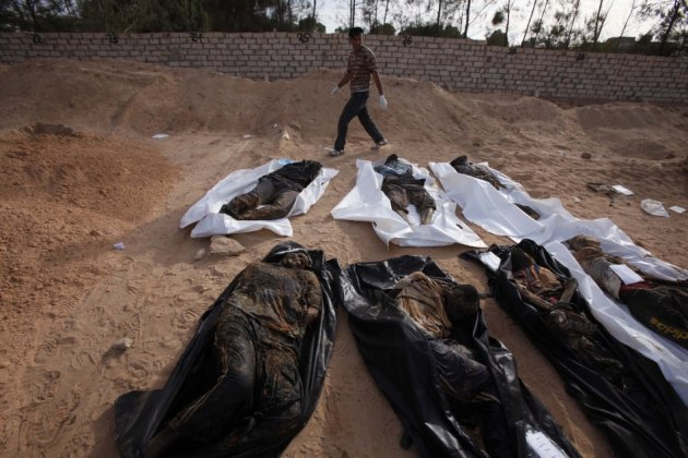 Wrapped corpses in Wadi Zine village