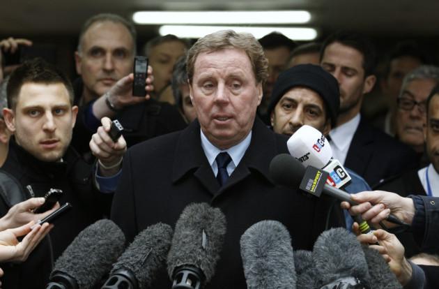 Tottenham Hotspur soccer manager Harry Redknapp speaks to members of the media as he leaves Southwark Crown Court in London