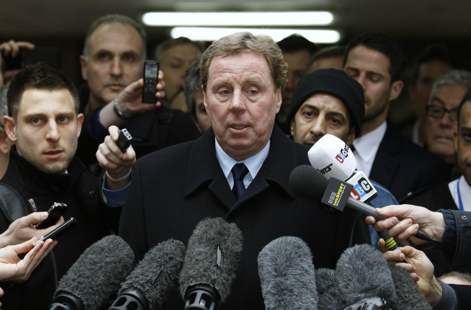 Tottenham Hotspur soccer manager Harry Redknapp speaks to members of the media as he leaves Southwark Crown Court in London