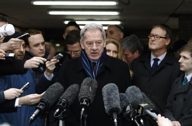 Milan Mandaric speaks to members of the media as he leaves Southwark Crown Court in London