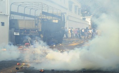 Teargas clouds are seen during a clash between Maldives soldiers and supporters of opposition parties and police in Male