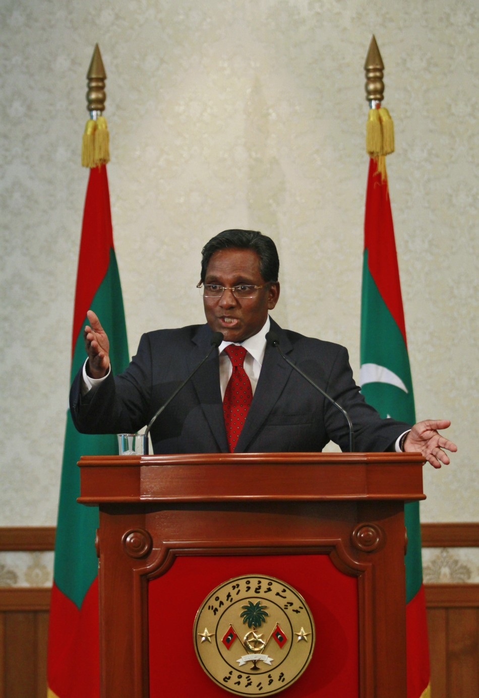 Maldives' newly appointed President Manik speaks during a news conference in Male