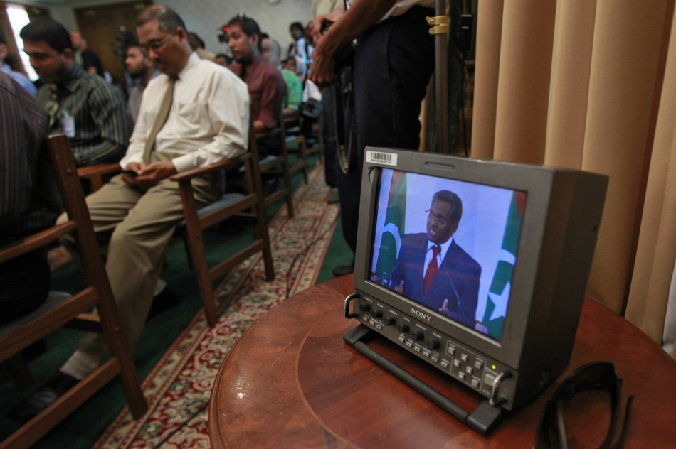 Maldives' newly appointed President Manik is seen on a monitor as he speaks during a news conference at the presidential office in Male
