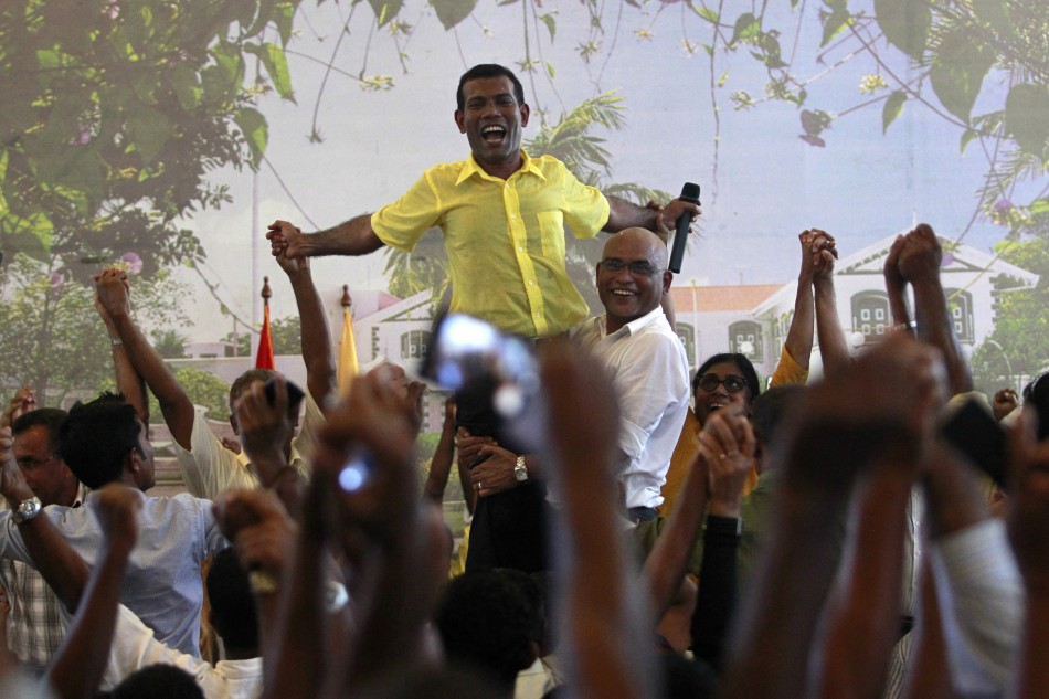 Ousted Maldivian president Mohamed Nasheed is carried by his supporters in Male