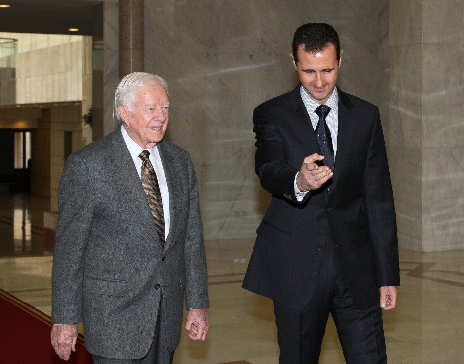 Syria's President Bashar al-Assad welcomes former U.S. President Jimmy Carter before a meeting in Damascus