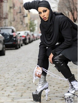 Muslim model demonstrates how to dress fashionably, yet modestly