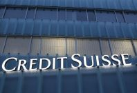 A Credit Suisse logo is seen on a Credit Suisse office building in Guemligen