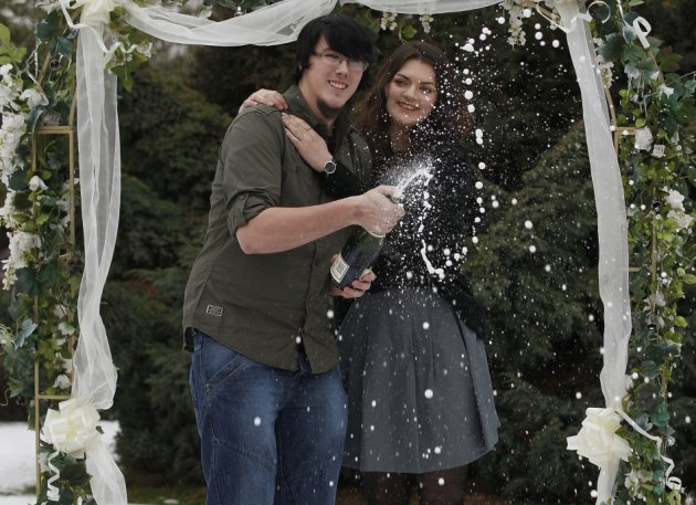 Cassey Carrington and Matt Topham pose for photographers after their £45m EuroMillions win (Reuters)