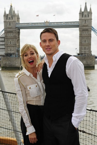 British actress Sienna Miller and U.S. actor Channing Tatum pose for photographers during a photocall to promote their new film G.I. Joe, in front of Tower Bridge, on HMS Belfast on the River Thames in London