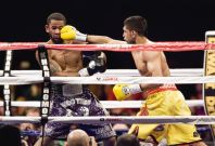 Khan hits Peterson during the third round of their WBA super lightweight and IBF Junior welterweight title fight in Washington