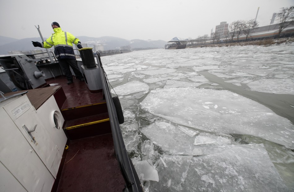Kronsteiner, an official of harbour authority watches as the icebreaker boat makes its way through frozen Danube harbour in Linz