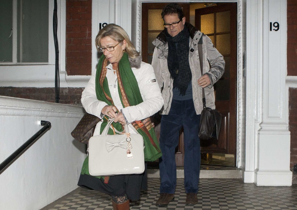 Former England football manager Fabio Capello leaves his Belgravia home with his wife Laura, the morning after resigning his post