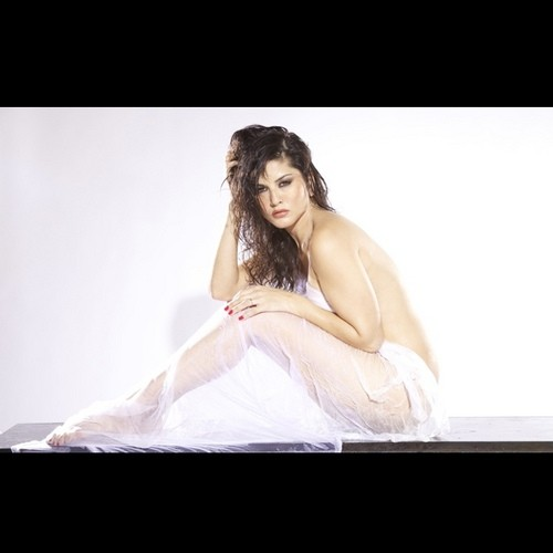 Sunny Leone clad in a white bed sheet