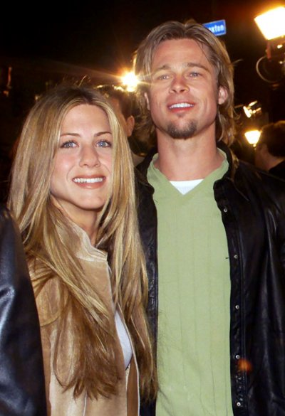 Actress Jennifer Aniston L and then boyfriend and actor Brad Pitt
