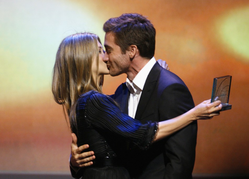 Actress Jennifer Aniston is presented with the Vanguard Award by Jake Gyllenhaal