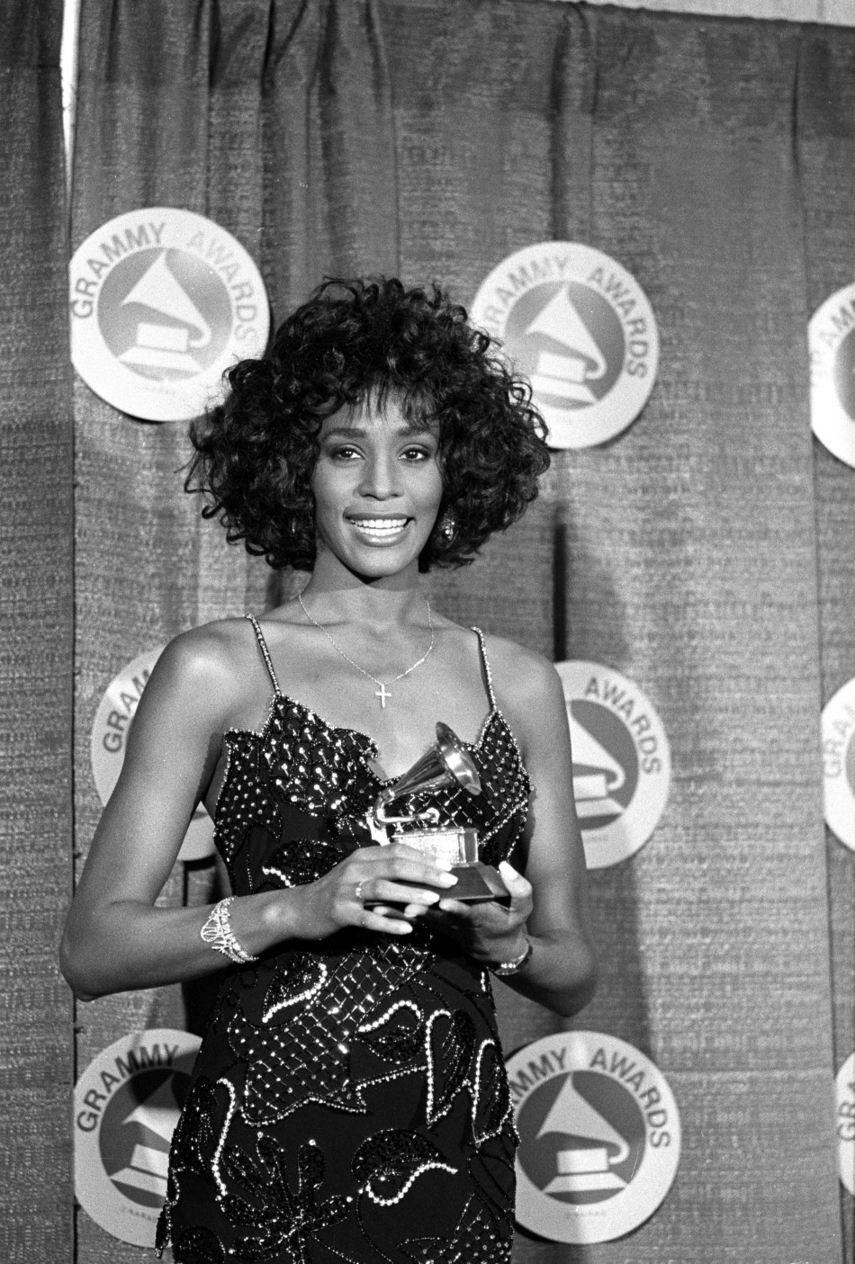 Houston poses with her Grammy after she was named Best Pop Vocal Performer-Female at the 30th annual Grammy Awards at New Yorks Radio City Music Hall