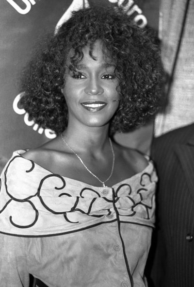 Whitney Houston smiles at a news conference in New York on July 11, 1988
