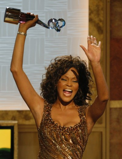 Whitney Houston reacts after receiving the BET Honors for Entertainment in Washington