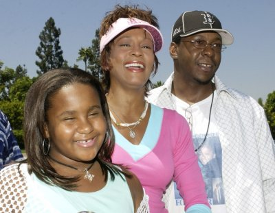 Singer and actress Whitney Houston C, a producer on the family comedy motion picture quotThe Princess Diaries 2 Royal Engagement,quot poses with her husband, singer Bobby Brown and their daughter Bobbi  as they arrive for the premiere