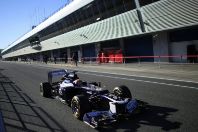 Williams Formula One driver Maldonado of Venezuela drives the FW34 in the pit-lane in Jerez