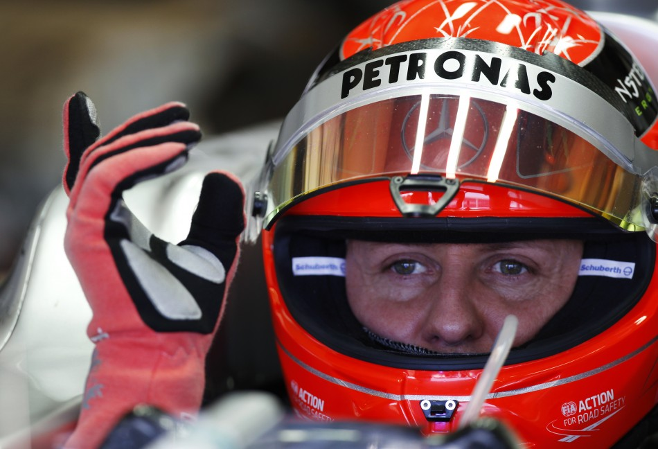 Mercedes F1 driver Schumacher of Germany is seen in the garage during a training session at the Jerez racetrack