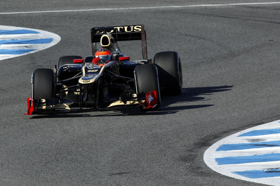 Lotus Formula One driver Romain Grosjean of France takes a curve in Jerez