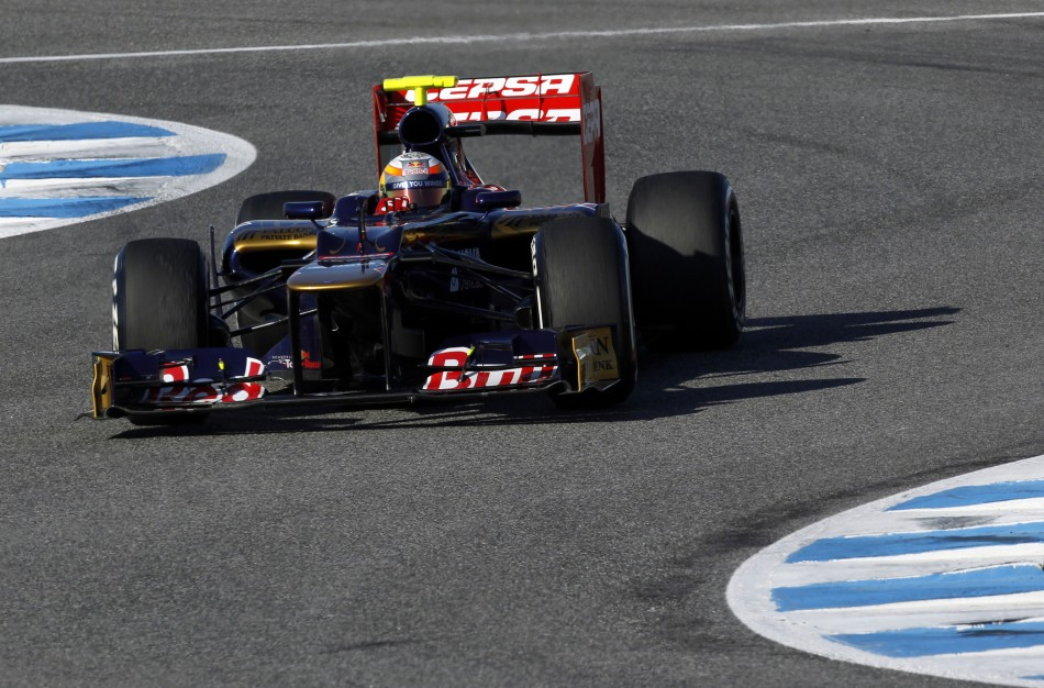 Toro Rosso Formula One driver Jean-Eric Vergne of France takes a curve in Jerez