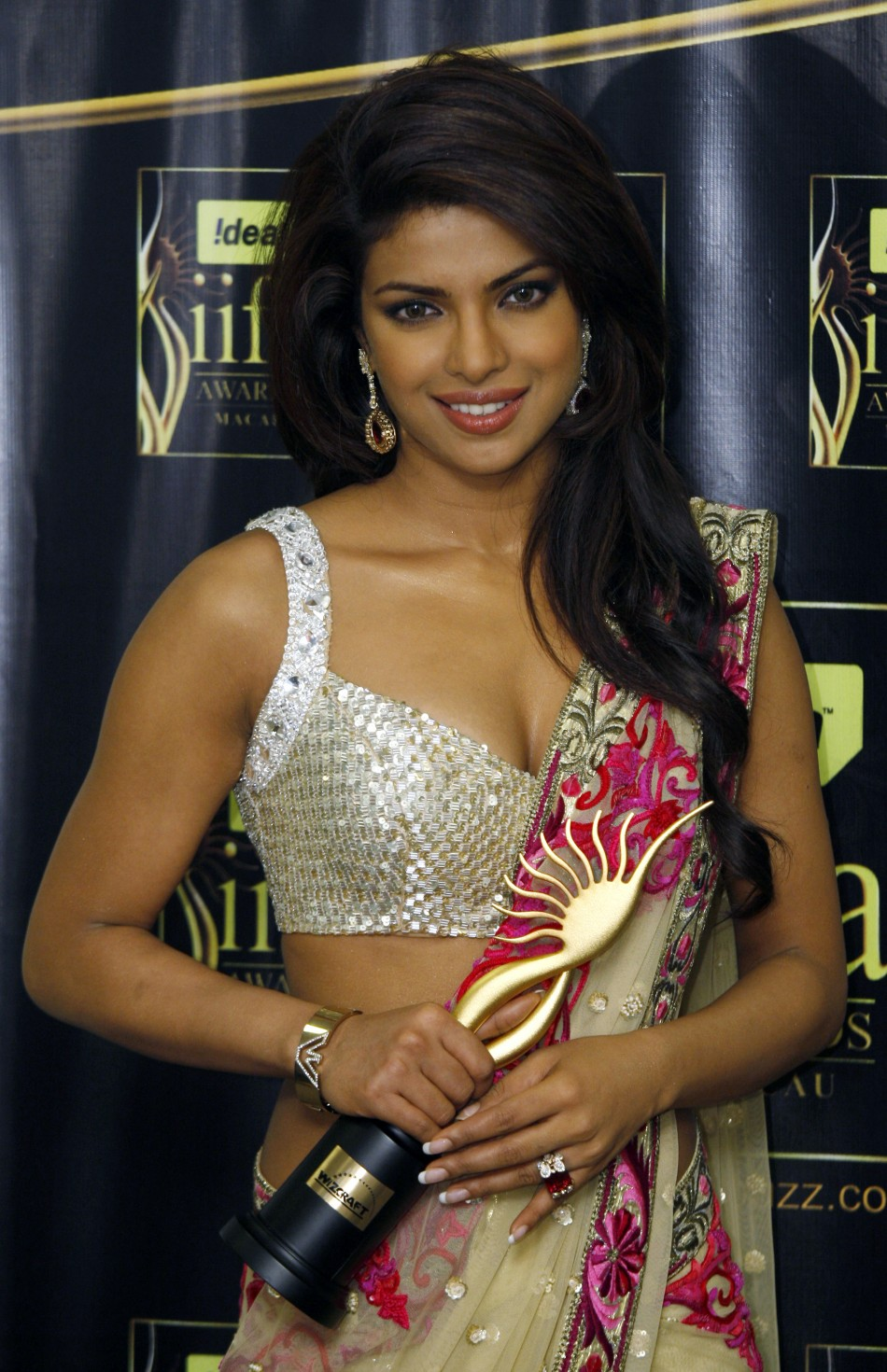 Chopra celebrates after winning the Leading Role Female award at the 10th International Indian Film Academy in Macau