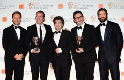 Jean Dujardin, Thomas Langmann and Michel Hazanavicius flanked by Russell Crowe and Hugh Jackman