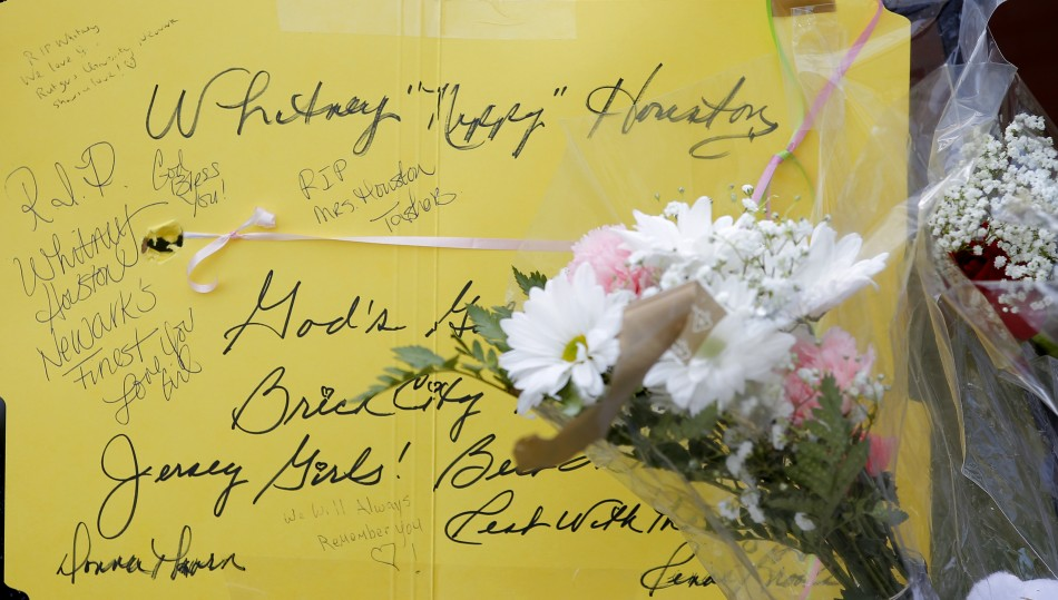 Messages are left for Whitney Houston at a makeshift memorial in front of The New Hope Baptist Church in Newark