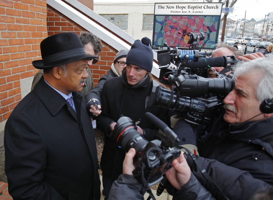 Civil rights leader Reverend Jesse Jackson speaks with the media outside The New Hope Baptist Church where Whitney Houston sang in the choir to mourn the death of the singer in Newark