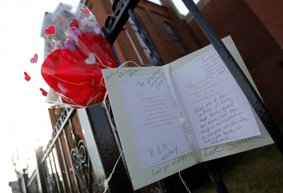 Flowers and a card are seen left as a memorial to deceased singer Whitney Houston, in front of the New Hope Baptist Church in New Jersey