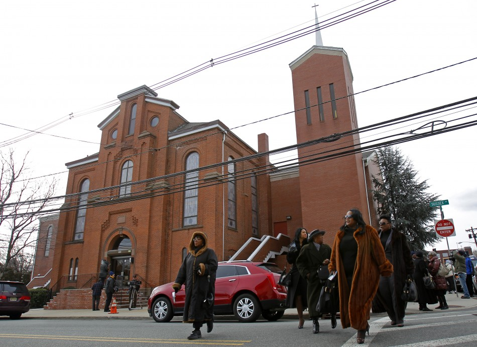 Parishioners of The New Hope Baptist Church where Whitney Houston sang in the choir leave after a morning service in Newark