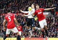 Manchester United's Evans challenges Liverpool's Carroll during their English Premier League soccer match in Manchester