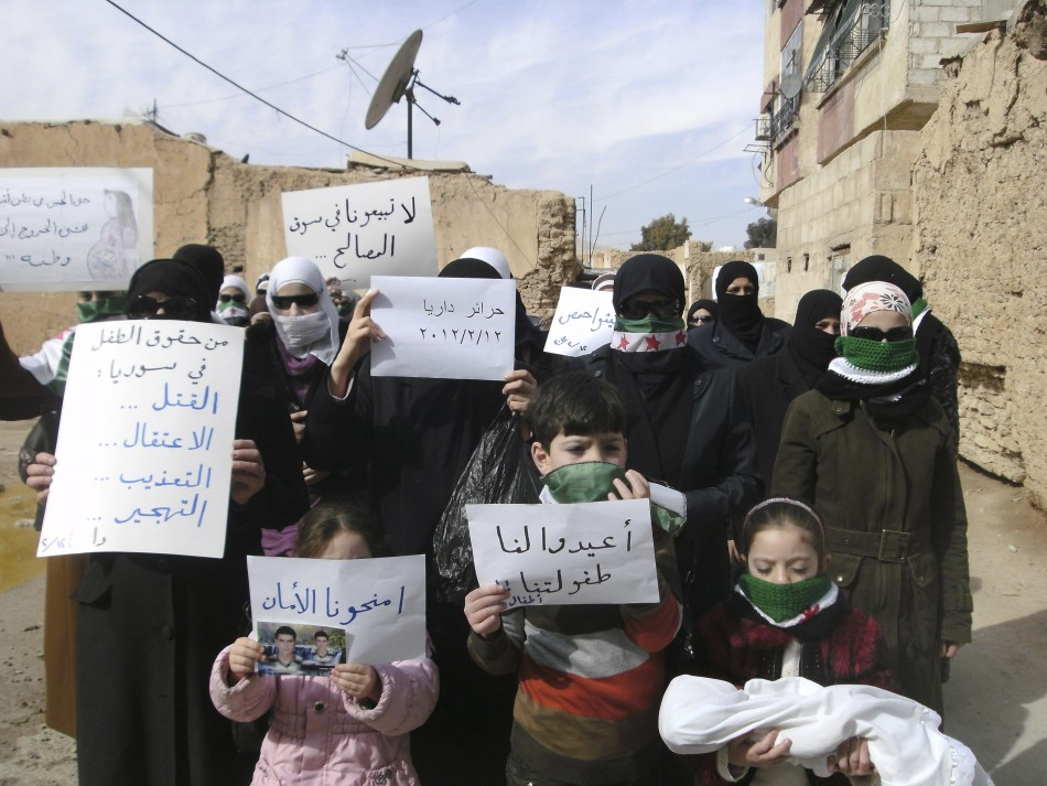 Demonstrators gather during a protest against Syria's President Bashar al-Assad in Daria, near Damascus
