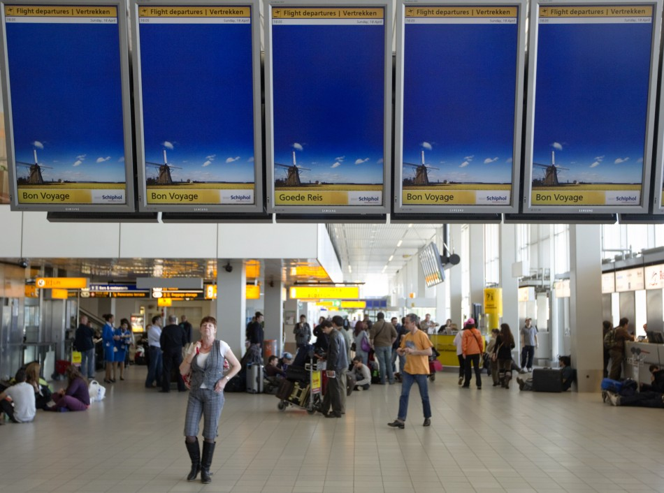 Travellers in departure lounge of Schiphol Airport in Amsterdam