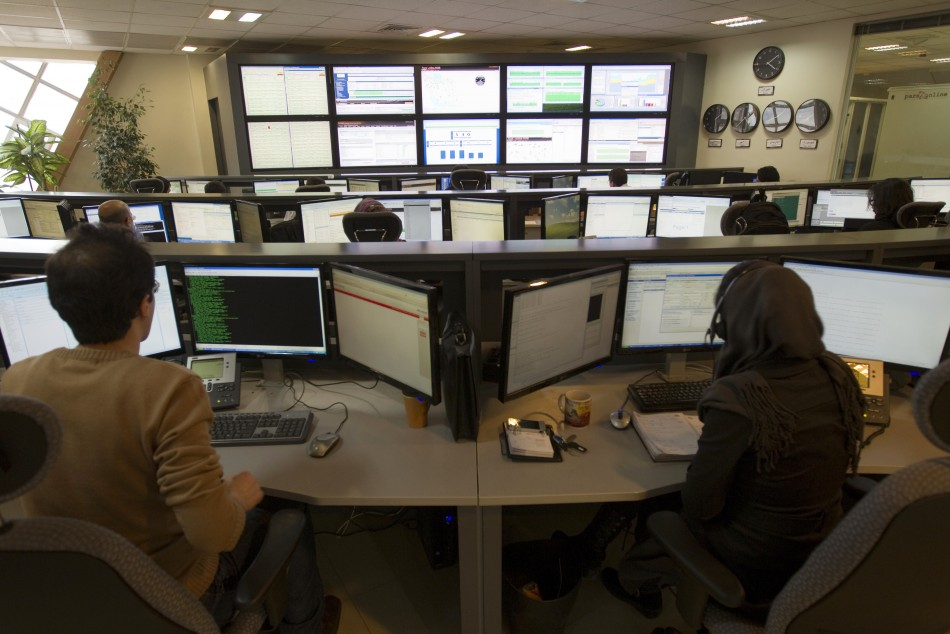 Technicians monitor data flow in the control room of an internet service provider in Tehran .