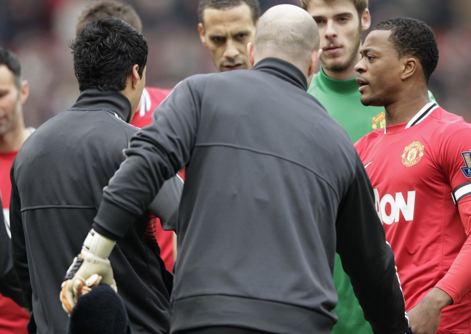 Partice Evra reacts to Luis Suarez's snub in the handshake line on Saturday.